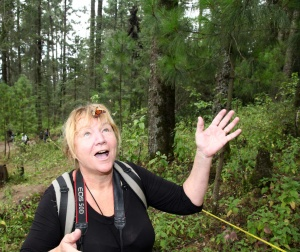 Sol publisher Dot Bell shows her excitement as a Monarch Butterfly lands on her forehead