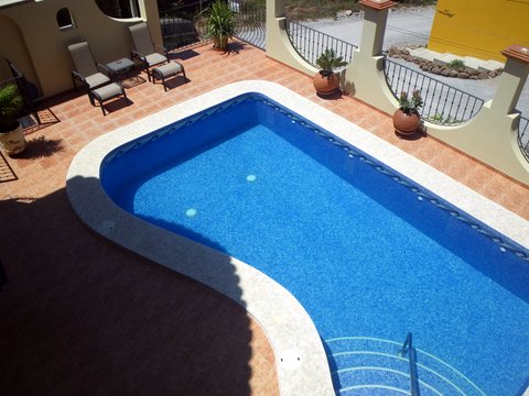 View of pool from upper patio